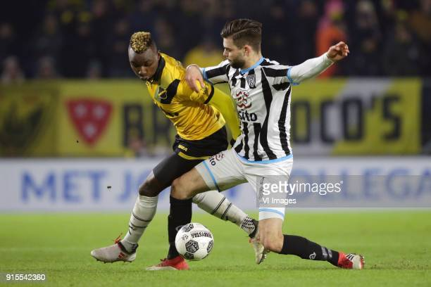 Thierry Ambrose of NAC Breda Robin Propper of Heracles Almelo during the Dutch Eredivisie match between NAC Breda and Heracles Almelo at the Rat...