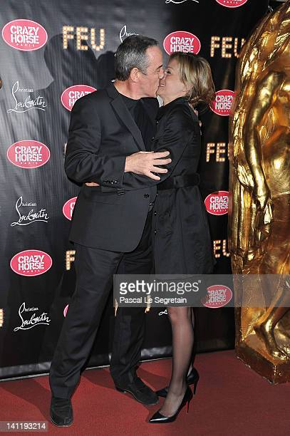 Thierry Ardisson kisses his wife during the VIP Premiere of 'Feu' Directed By Christian Louboutin at Le Crazy Horse on March 12 2012 in Paris France