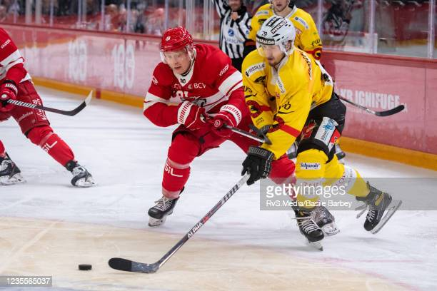 Thierry Bader of SC Bern battles for the puck with Ronalds Kenins of Lausanne HC during the Swiss National League game between Lausanne HC and SC...