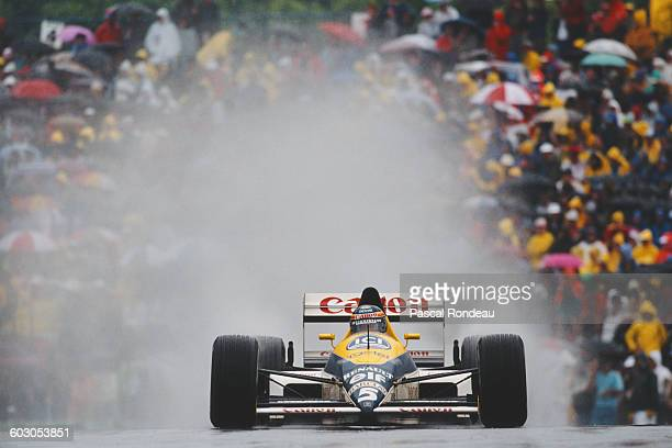 Thierry Boutsen of Belgium drives the Canon Williams Team Williams FW12C Renault V10 in the rain during the Canadian Grand Prix on 18 June 1989 at...