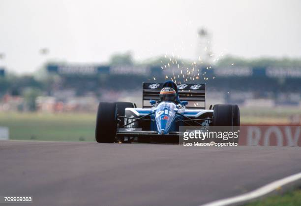 Thierry Boutsen of Belgium, driving a Ligier JS35B with a Lamborghini 3512 3.5V12 engine for Ligier Gitanes, during the British Formula One Grand...