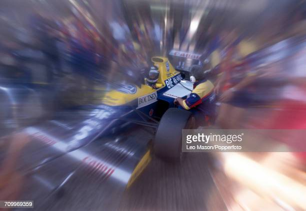 Thierry Boutsen of Belgium, driving a Williams FW13B with a Renault RS2 3.5 V10 engine for Canon Williams Renault, enroute to placing second during...