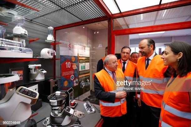 Thierry de la Tour d'Artaise chairman and CEO of French electrical goods company Groupe SEB French Prime Minister Edouard Philippe and French Junior...