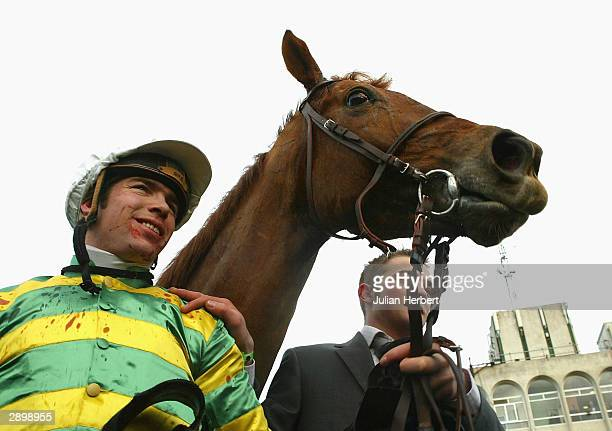 Thierry Doumen and Foreman return after landing The AIG Europe Champion Hurdle Race run at Leopardstown Racecourse on January 25 2004 in Dublin...