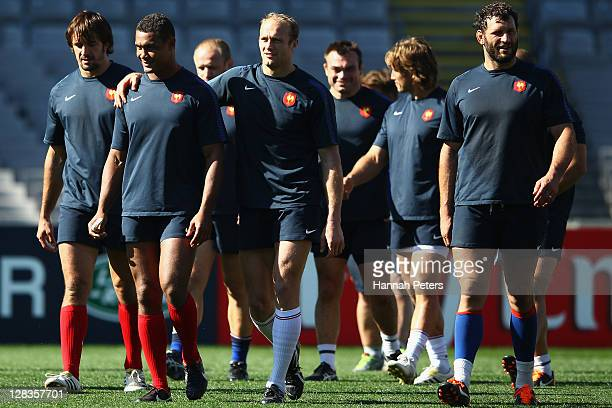 Thierry Dusautoir and Julien Bonnaire walk out with Lionel Nallet during a France IRB Rugby World Cup 2011 captain's run at Eden Park on October 7...