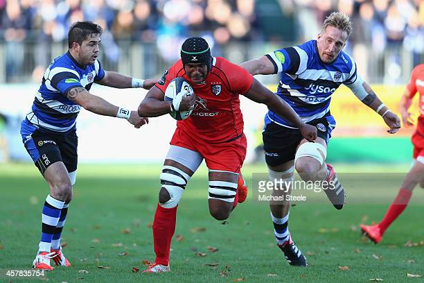 Thierry Dusautoir of Toulouse breaks through the challenge of Dominic Day and Horacio Agulla of Bath during the European Rugby Champions Cup Pool...