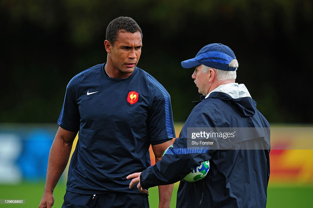 Thierry Dusautoir (L) the captain of France speaks with defence coach Dave Ellis (R) during a France IRB Rugby World Cup 2011 training session at Onewa Domain on October 19, 2011 in Takapuna, New Zealand.