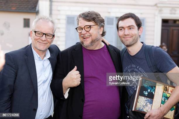 Thierry Fremaux and director Guillermo del Toro pose with fan as they arrive for premiere of 'The Shape of Water' at Lumiere Brothers Institut during...
