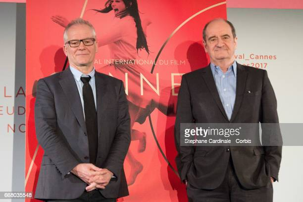 Thierry Fremaux and Pierre Lescure pose with the Cannes Film Festival Official Poster of the 70th edition after the Cannes Film Festival Press...