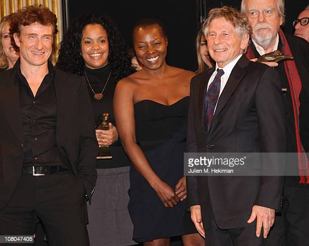 Thierry Fremont Yahima Torres guest Roman Polanski and Michael Lonsdale pose together during the 16th 'Cerememonie Des Lumieres' at Hotel de Ville on...