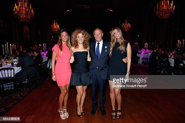 Thierry Gaubert and Valentina Colombo with his daughters Milena and Nastasia attend the Grand Bal de Deauville For Care France Association in Casino...