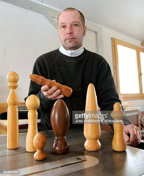 Thierry Germain a French carpenter poses with wooden dildos in his studio on February 8 2013 in BassesurleRupt eastern France Germain manufactures...