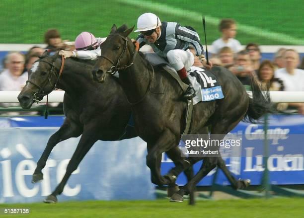 Thierry Gillet and Bago get the better of the Cristophe Soumillon ridden Cherry Mix to land The Prix De L'Arc De Triomphe Race run at Longchamp...