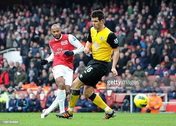 Thierry Henry 2of Arsenal scores Arsenal's 7th goal past Scott Dann of Blackburn during the Barclays Premier League match between Arsenal and...