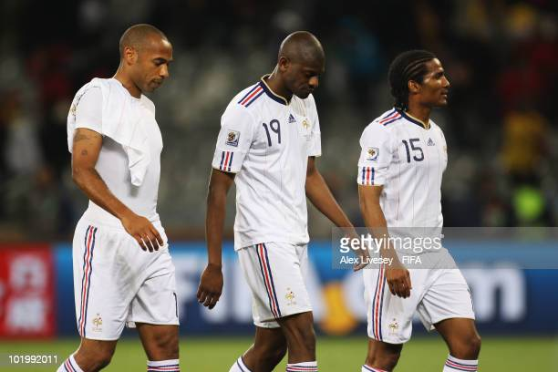 Thierry Henry Abou Diaby and Florent Malouda of France leave the pitch after the 2010 FIFA World Cup South Africa Group A match between Uruguay and...