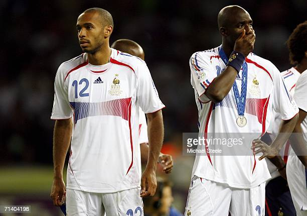 Thierry Henry and Alou Diarra of France look on following their team's defeat during the FIFA World Cup Germany 2006 Final match between Italy and...