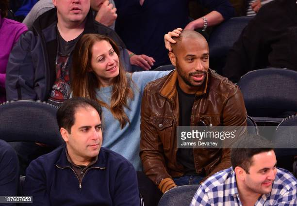 Thierry Henry and Andrea Rajacic attend the San Antonio Spurs vs New York Knicks game at Madison Square Garden on November 10 2013 in New York City