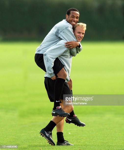 Thierry Henry and Dennis Bergkamp of Arsenal during Arsenal 1st team training session at Arsenal Training Ground on October 15 2001 in St Albans...