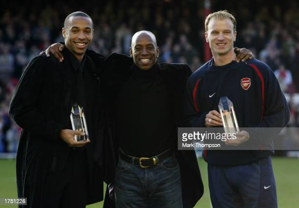 Thierry Henry and Dennis Bergkamp of Arsenal with exArsenal player Ian Wright before the FA Cup fourth round match between Farnborough Town and...
