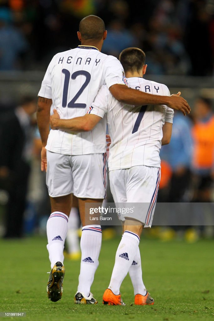Thierry Henry and Franck Ribery of France walk off the pitch after a draw in their 2010 FIFA World Cup South Africa Group A match between Uruguay and France at Green Point Stadium on June 11, 2010 in Cape Town, South Africa.
