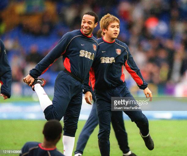 Thierry Henry and Junich Inamoto of Arsenal warm up before the Premier League match between Everton and Arsenal on February 10, 2002 in Liverpool,...