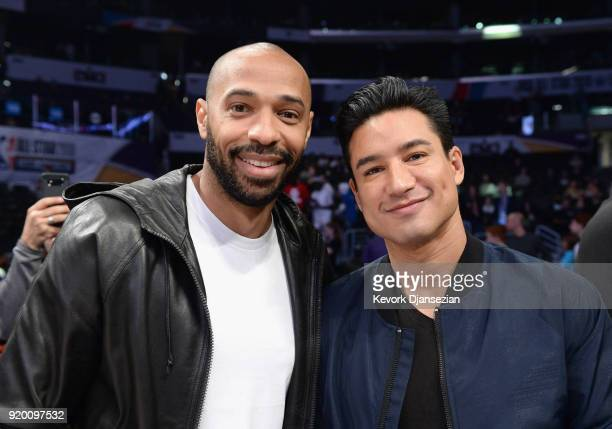 Thierry Henry and Mario Lopez attend the NBA AllStar Game 2018 at Staples Center on February 18 2018 in Los Angeles California