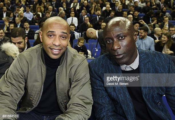 Thierry Henry and Ozwald Boateng sit courtside at the NBA Global Game London 2017 basketball game between the Indiana Pacers and Denver Nuggets at...
