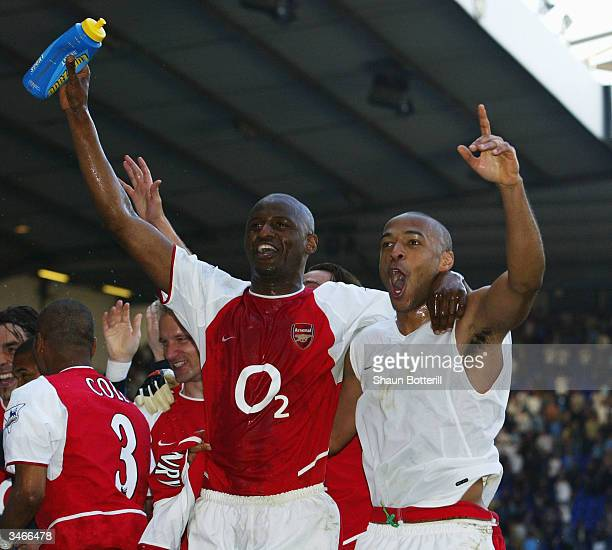 Thierry Henry and Patrick Vieira of Arsenal celebrates with teammates at the end of the FA Barclaycard Premiership match between Tottenham Hotspur...