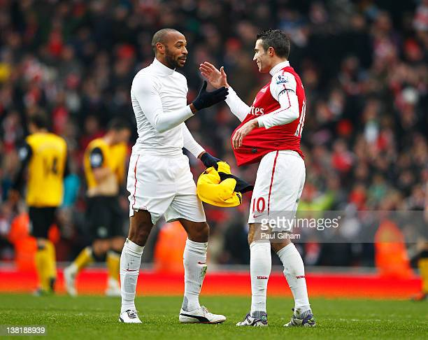 Thierry Henry and Robin van Persie celebrate after Arsenal won 7-1 during the Barclays Premier League match between Arsenal and Blackburn Rovers at...