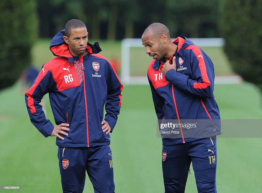 Thierry Henry and Ryan Garry Arsenal Coach during the U19 training session at London Colney on September 15, 2015 in St Albans, England.