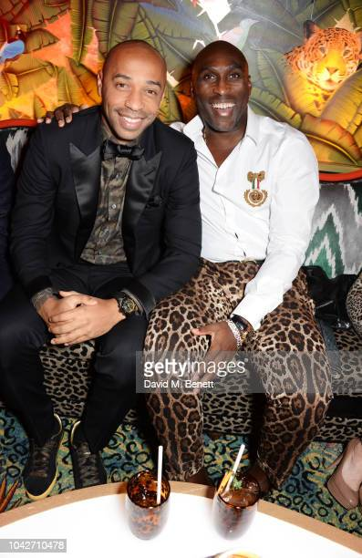 Thierry Henry and Sol Campbell attend the Jungle Party at Annabel's on September 28 2018 in London England