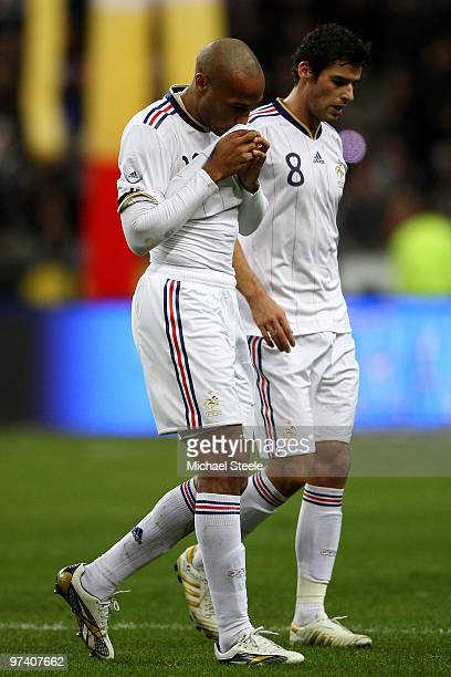 Thierry Henry and Yoann Gourcuff walk off dejectedly at the end of the first half during the France v Spain International Friendly match at the Stade...