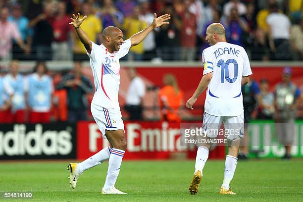 Thierry Henry and Zinedine Zidane celebrate during the FIFA World Cup quarter final match between Brazil and France.