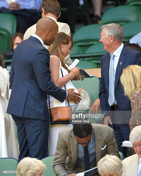 Thierry Henry Andrea Rajacic and Sir Alex Ferguson attend day eleven of the Wimbledon Tennis Championships at Wimbledon on July 10 2015 in London...