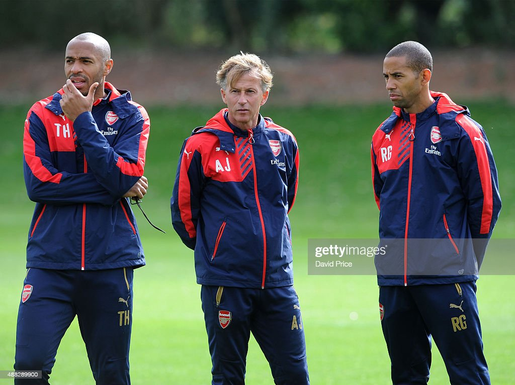 Thierry Henry, Andries Jonker and Ryan Garry Arsenal Coach during the U19 training session at London Colney on September 15, 2015 in St Albans, England.