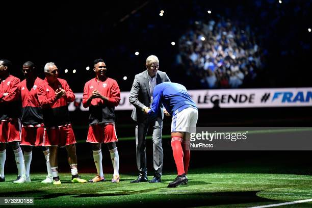 Thierry Henry arrives on the pitch to play with the France 98 team and salute his former coach arsen wenger at the UArena in Nanterre on the 12 June...