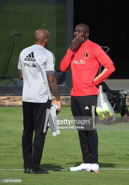 """Thierry Henry, assistant coach of Belgium, and Romelu Lukaku of Belgium during a training session of the Belgian national soccer team """" The Red..."""
