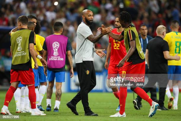 Thierry Henry assistant head coach / manager of Belgium celebrates at the end of the 2018 FIFA World Cup Russia Quarter Final match between Brazil...