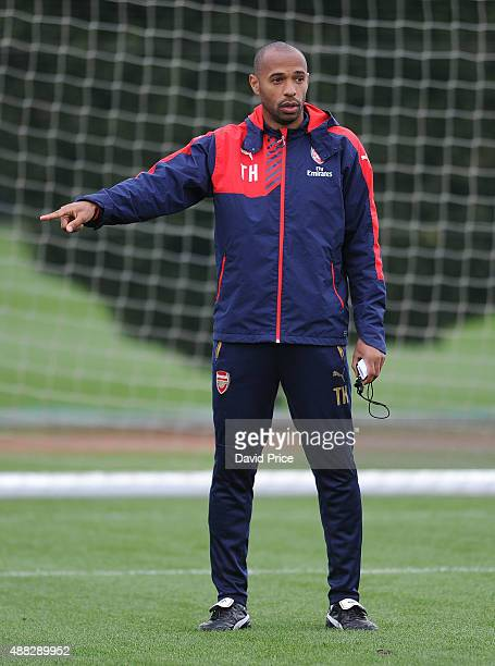 Thierry Henry assisting with the coaching session during the U19 training session at London Colney on September 15 2015 in St Albans England