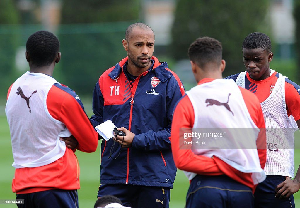 Thierry Henry assisting with the coaching session during the U19 training session at London Colney on September 15, 2015 in St Albans, England.