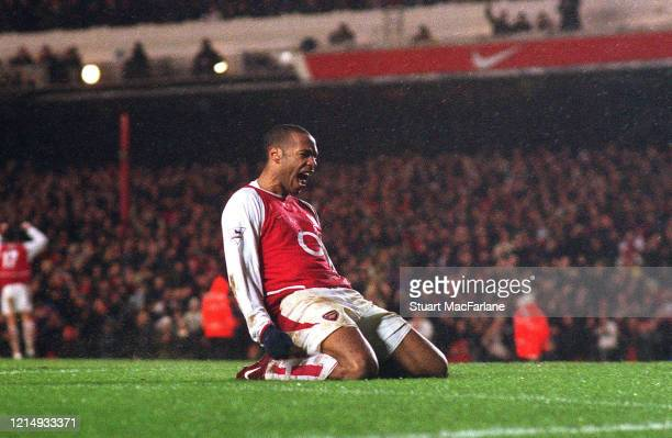 Thierry Henry celebrates scoring a goal during the Premier League match between Arsenal and Manchester City on February 1, 2004 in London, England.
