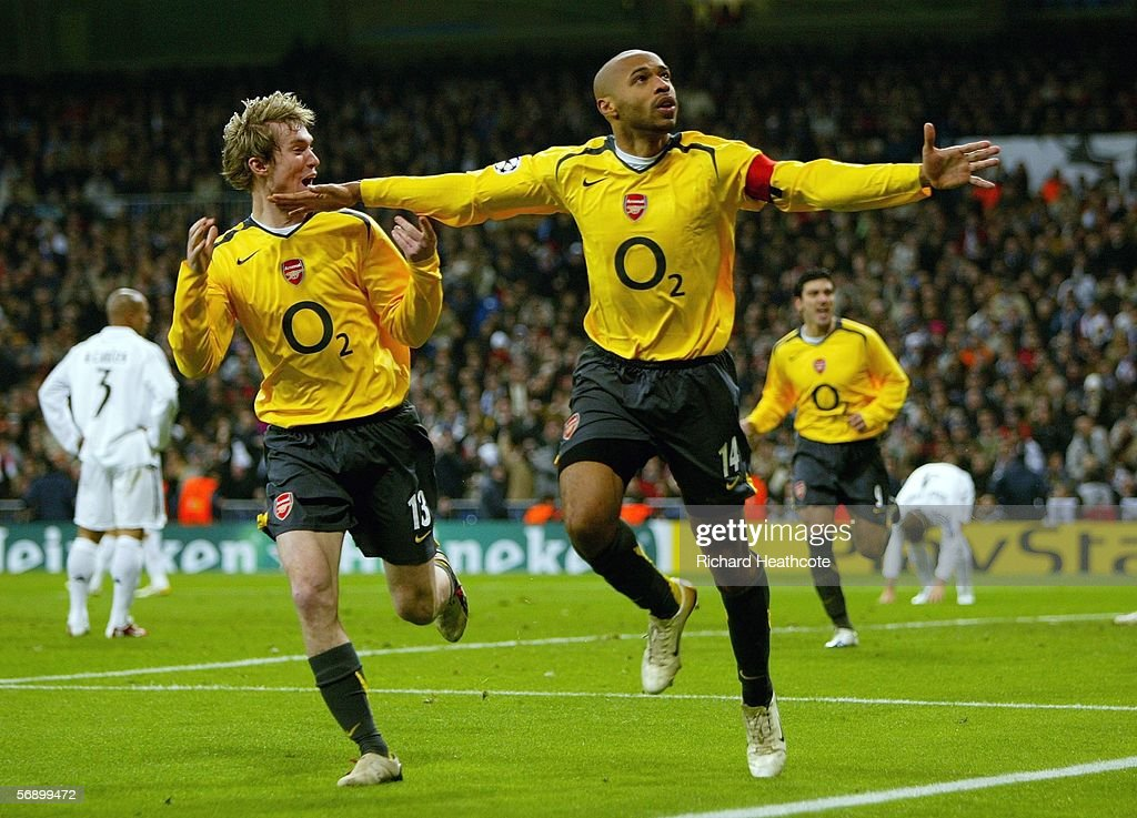 Thierry Henry celebrates scoring the first goal for Arsenal during the UEFA Champions League Round of 16, First Leg match between Real Madrid and Arsenal at the Santiago Bernabeu Stadium on February 21, 2006 in Madrid, Spain.