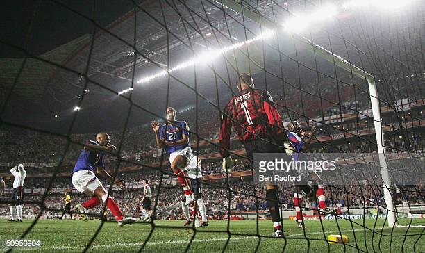Thierry Henry David Treseguet and Sylvain Wiltord of France celebrate Zinedin Zidane's first goal as David James of England kicks the ball away...