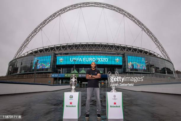 Thierry Henry, Global Heineken® Ambassador with the EURO 2020 Trophy and UEFA Champions League Trophy to announce Heineken's sponsorship of the EURO...