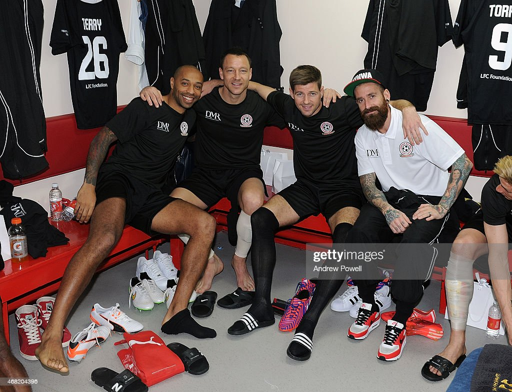 Thierry Henry, John Terry, Steven Gerrard and Raul Meireles in the dressing room before the Liverpool All Star Charity Match at Anfield on March 29, 2015 in Liverpool, England.