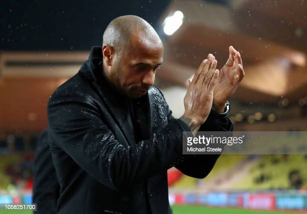 Thierry Henry Manager of Monaco applauds fans following his team's defeat in the the Group A match of the UEFA Champions League between AS Monaco and...