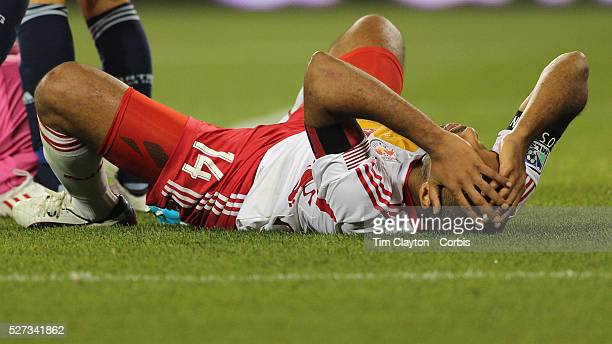 Thierry Henry New York Red Bulls after taking a tumble while challenging Sporting Kansas City goalkeeper Jimmy Nielsen during the New York Red Bulls...