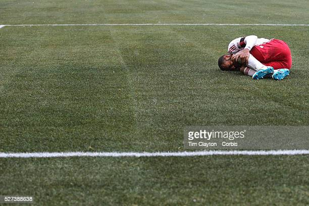 Thierry Henry New York Red Bulls holds his knee after taking a knock in action during the New York Red Bulls V DC United Major League Soccer regular...