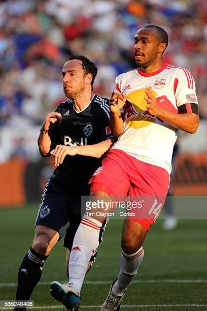 Thierry Henry, New York Red Bulls, is challenged by Andy O'Brien, Vancouver Whitecaps, during the New York Red Bulls V Vancouver Whitecaps FC, Major...
