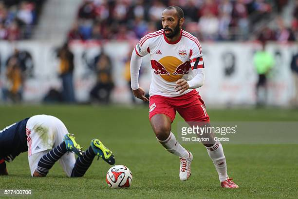 Thierry Henry New York Red Bulls is challenged by Jermaine Jones New England Revolution during the New York Red Bulls Vs New England Revolution MLS...